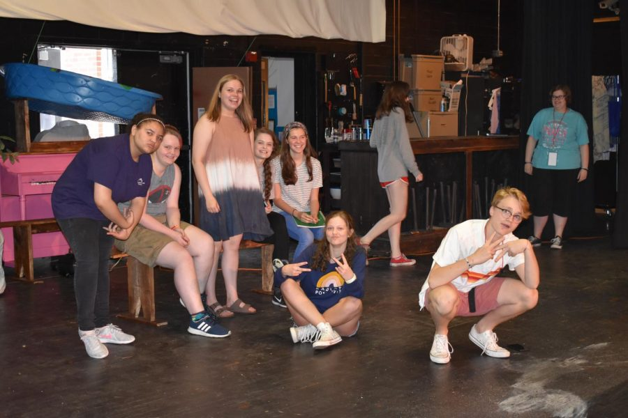 Students in drama class pose for a photo