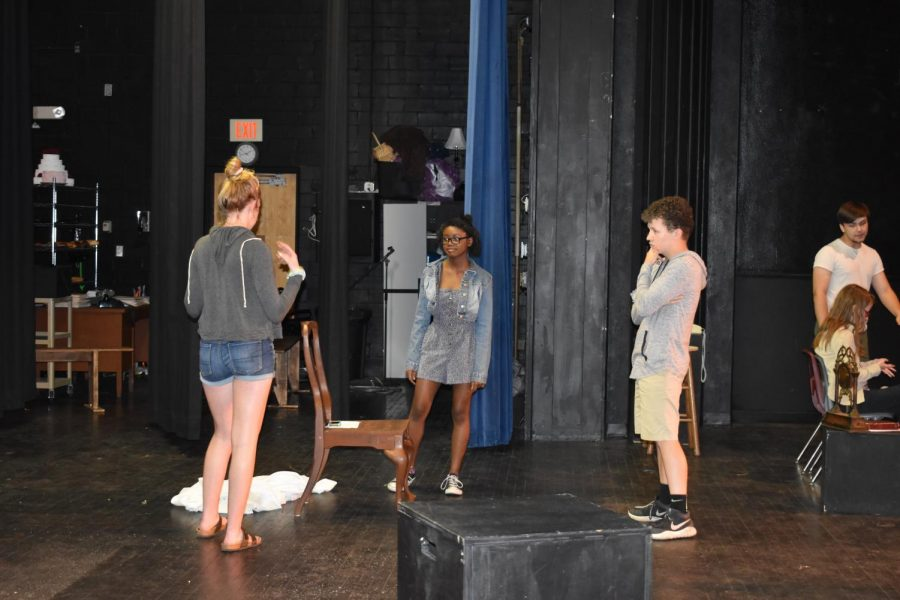 A group of students rehearse their for their finals