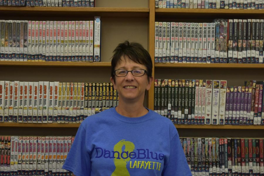 Mrs. Guth poses for a photo for her retirement in May 2018