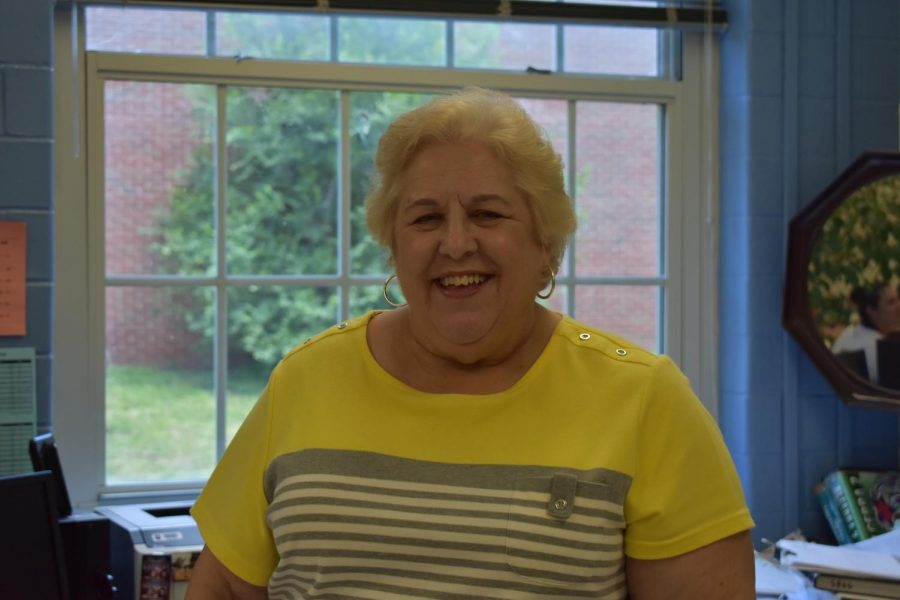 Mrs. Waespe poses for photo for her retirement May 2018