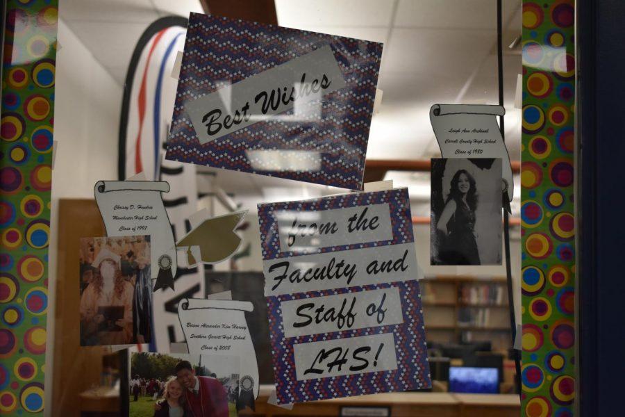 Library window of staff congratulating seniors