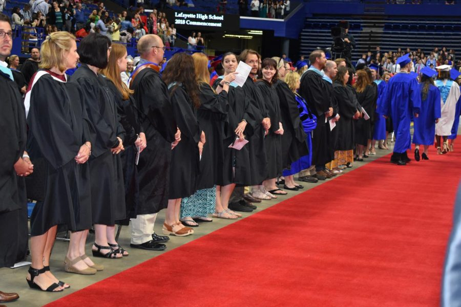 Lafayette teachers watch as the class of 2018 leave Rupp Arena after the graduation ceremony.