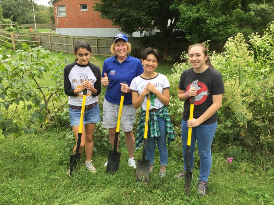 Bridget Bender, Sandy Shafer, Maya Mintu, Anne Elizabeth work on the Lone Oak Community Garden.