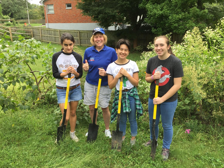 Bridget Bender, Sandy Shafer, Maya Mintu, Anne Elizabeth work on the Lone Oak Community Garden.