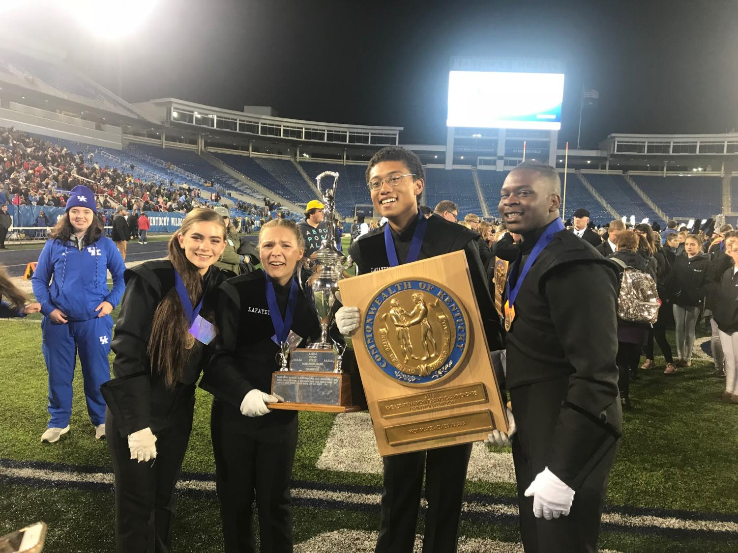 Starting from the left: Shannon James, Kate Manno, Casey Trowel, and  Ni'Kerrion McDonald, the Lafayette band drum majors.
