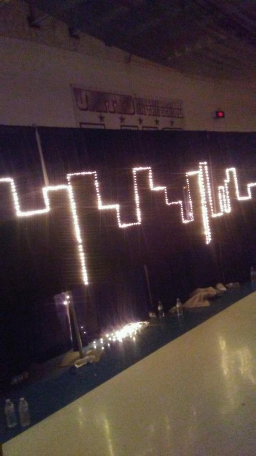 The light decorations hung in the shape of a city skyline