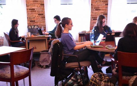 Madelyne Strauss and other students writing NaNoWriMo