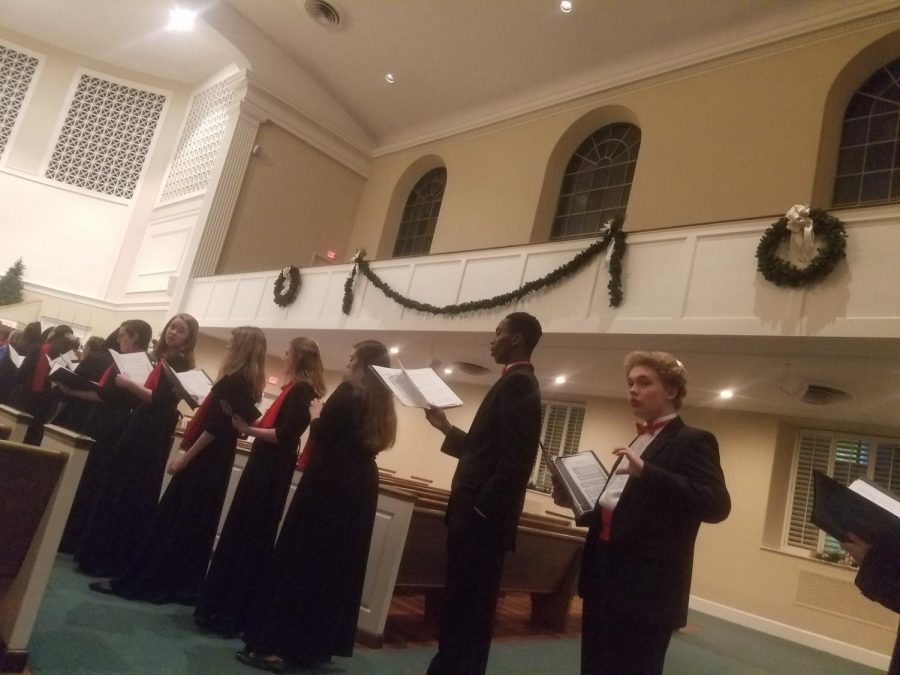 Members of the combined choirs rehearsing
