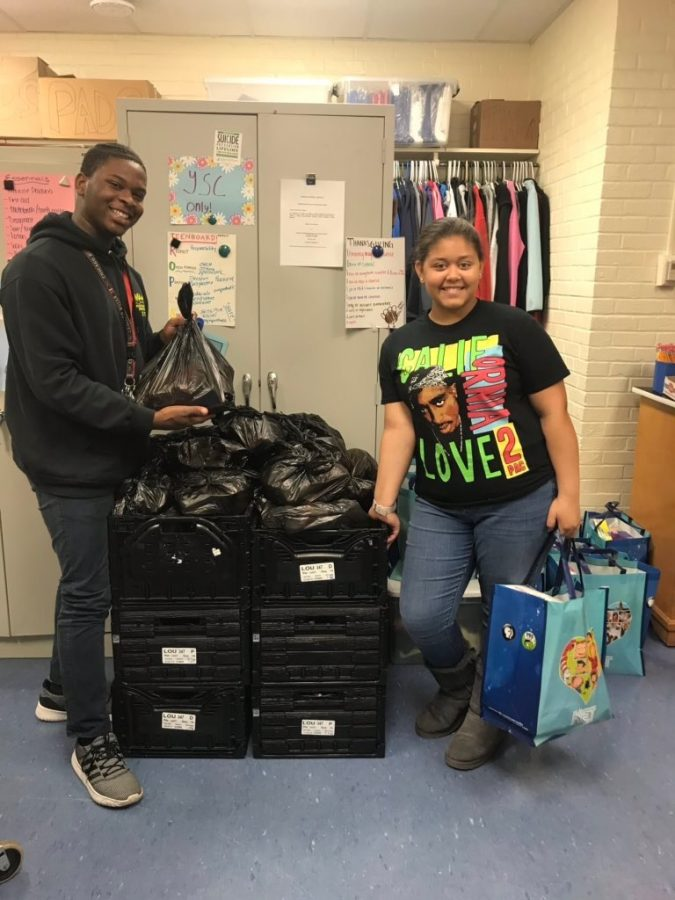 Ni'Kerrion McDonald and Kamille Bryant help organize bags for the YSC backpack program