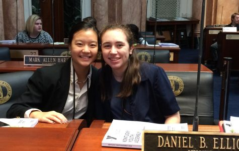Sharlene Wang and Anne Elizabeth Forker prepare for debate in the Kentucky House at the Capitol.