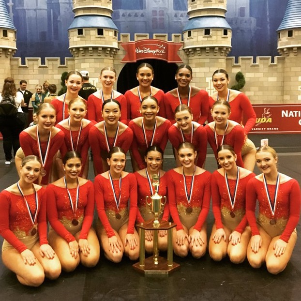 The+2018-2019+Dance+team+with+the+third+place+trophy.+