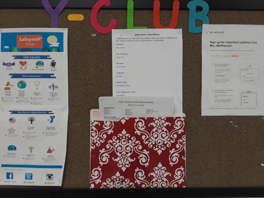 Y-Club bulletin board with announcements for the program.