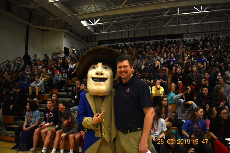 Our mascot The General and our associate principal Mr. David Scholl pose before the pep rally starts.