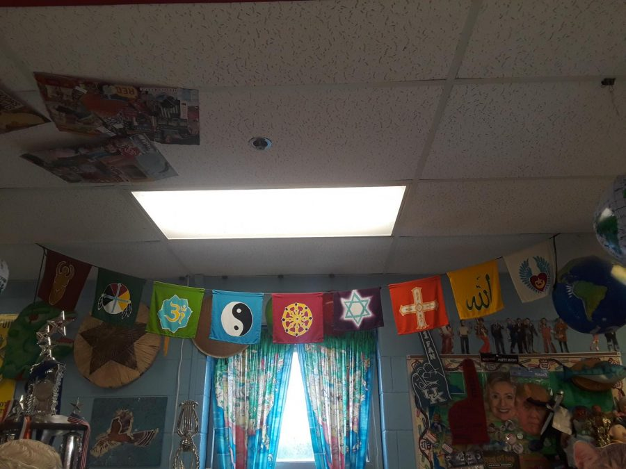 Various+religious+flags+hung+in+Ms.+Walker%27s+room.
