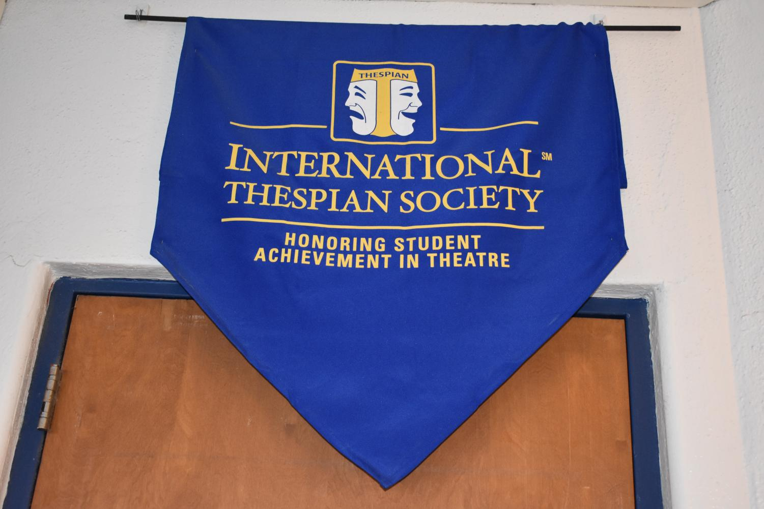 International Thespian Society banner hanging in the drama class.