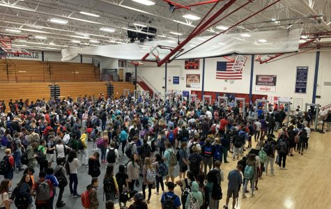 A panorama of the gymnasium during the peak of the morning rush, minutes before bag searches were stopped.