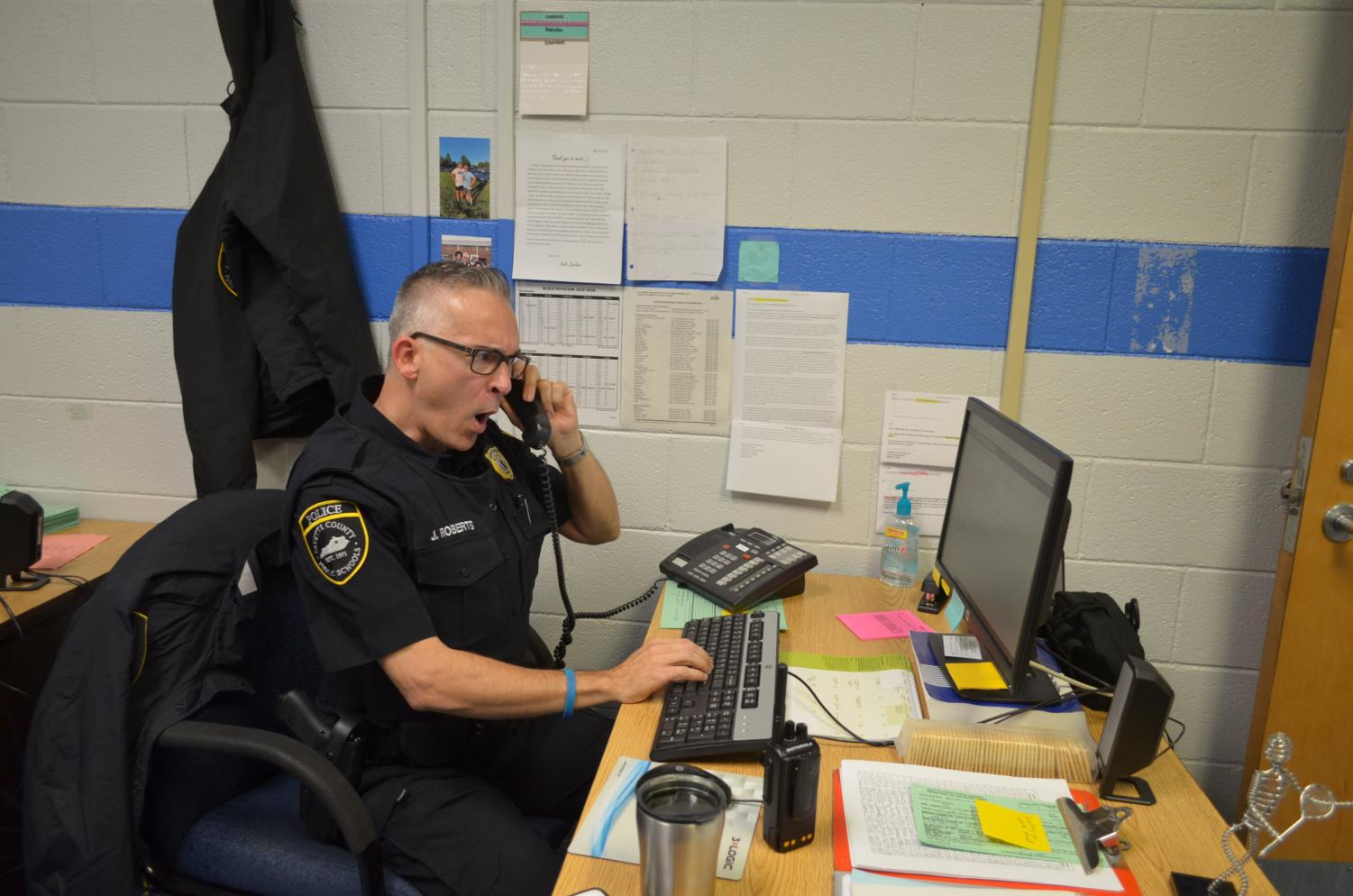 Officer Roberts working in his Office