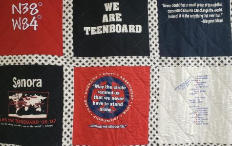 Picture of the Teenboard Quilt hanging in the Youth Services Center.