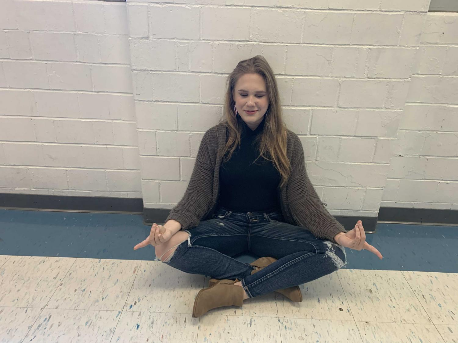 Student Emily Wrede participating in the mindful minute.
