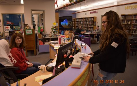 Dylan Proctor asks Librarian Stephanie Schoff for forgiveness on her library fine