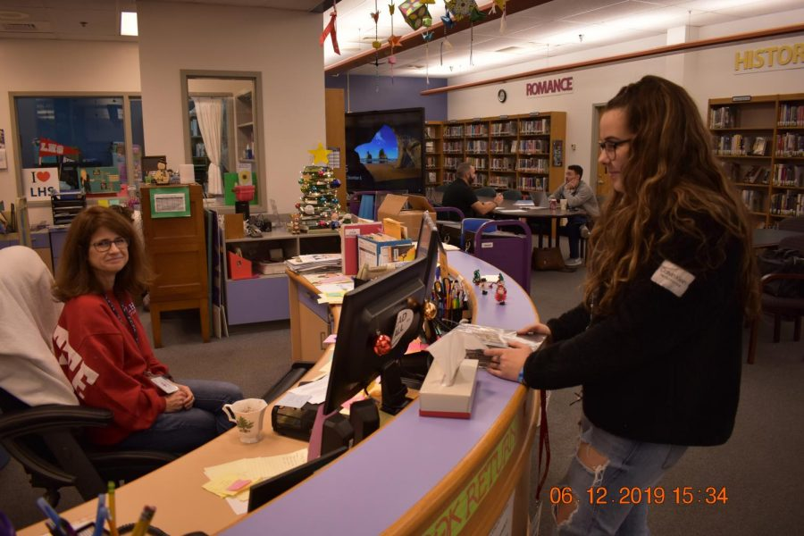 Dylan+Proctor+asks+Librarian+Stephanie+Schoff+for+forgiveness+on+her+library+fine