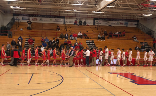 Lafayette shaking hands with Lincoln County at the end of the varsity game