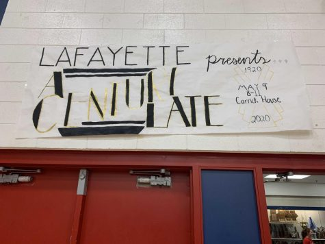 A poster hanging in the gym announces the 2020 Prom theme: the Roaring 20s--A Century Late.
