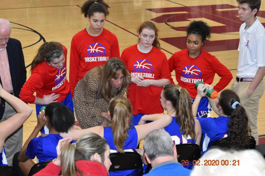Coach Denton, coach of the 2019-2020 Lafayette Girls' Basketball Team, addresses the team at a distric championship game prior to schools being closed due to the COVID-19 outbreak. Photo used from the Lafayette Times Media Archives.