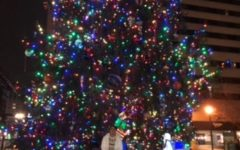 Lexington, Ky. A Lafayette student in front of the  downtown Lexington Christmas tree.