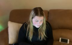 Lexington, Ky: A Kennedy Olsen, a Lafayette junior, uses technology to donate to a local charity.
