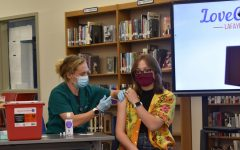 Lexington, KY. Lauren Clay Sampson, 10th grader receiving her first dose of the Covid-19 vaccination at Lafayette High School on the last day of school.