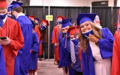 Lexington, Kentucky: Lafayette graduates are all smiles while waiting for the ceremony at Rupp Arena at Rupp to start.