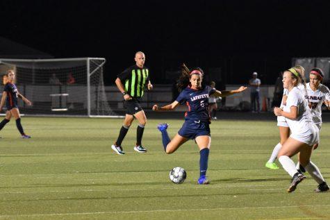[LEXINGTON, KY] Sophomore Brooke Dawahare takes hard shot on goal against cross-town rival Dunbar.
