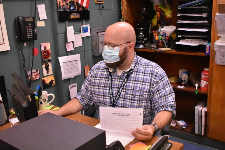 Lexington, KY. Spanish teacher Mr.Yeager is hard at work planning the National Spanish Honors Society movie night.
