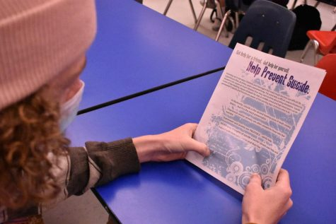 Lexington, KY. Leo Downs, a senior at Lafayette High School, reading a suicide prevention pamphlet from the Mental Health specialists at school.