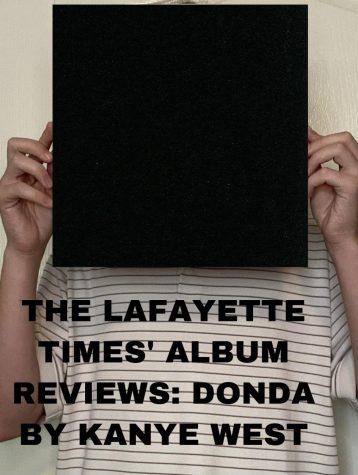 Writer, Asa Thomas poses with Kanye Wests new album, Donda.