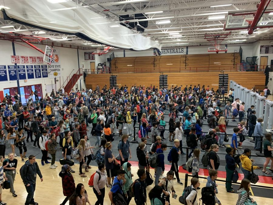 Lafayette Generals rushing through the morning metal detectors, trying to get to class on time. This photo was taken before the pandemic and students weren't required to wear masks.