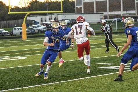 [LEXINGTON, KY] Everett Laurance (17) breaks a tackle from Blake van Horn (10) to return an interception for a touchdown.