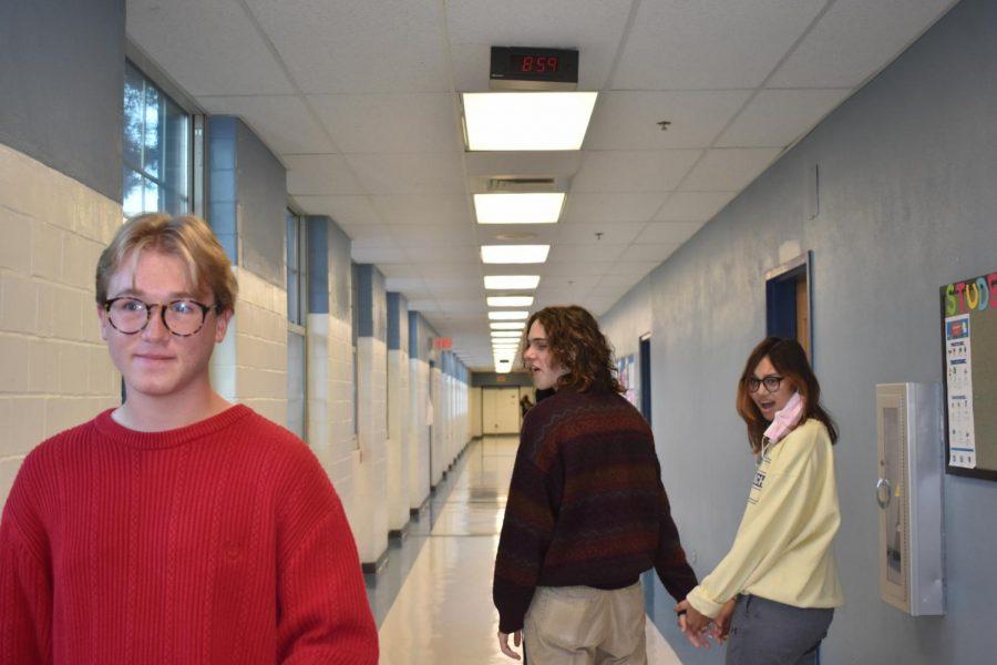 Asa Thomas, Noah Sprout, and Emma Taylor posing as a popular meme.