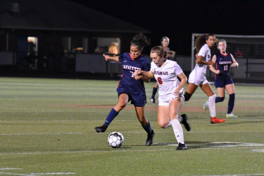 [LEXINGTON, KY] Grecia Martinez (7) defends a contested possession.