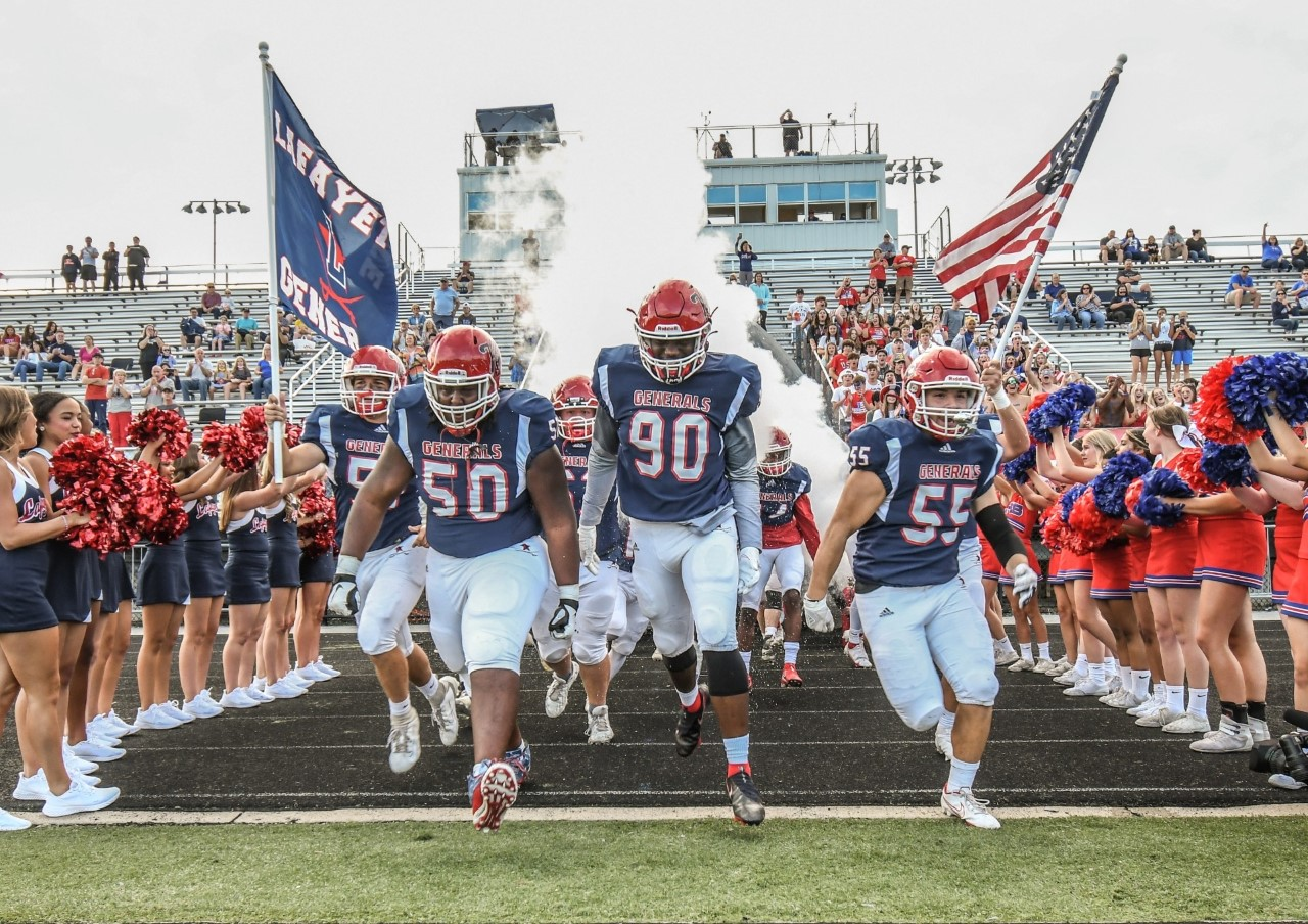 [LEXINGTON, KY] Dylan Womack (50), Donovan Jackson (90), and Ruben Garcia (55) are pictured as the Lafayette Generals take the field.