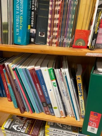 Lafayette teacher, Stevie Lemons, bookshelf with textbooks for US History Curriculum.
