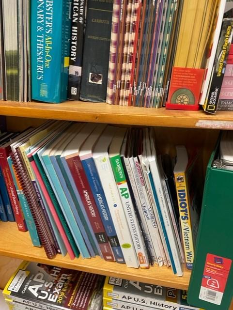 Lafayette+teacher%2C+Stevie+Lemons%2C+bookshelf+with+textbooks+for+US+History+Curriculum.